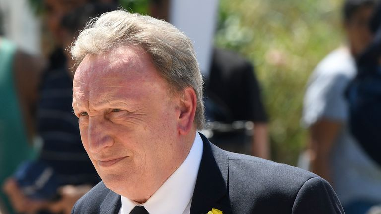 Neil Warnock wore a black suit with a yellow daffodil in tribute to Sala