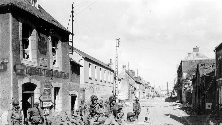 Allied troops advance during the D-Day landings.