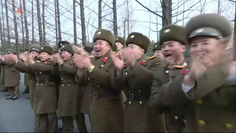 North Korean soldiers cheer as Kim Jong Un passes by