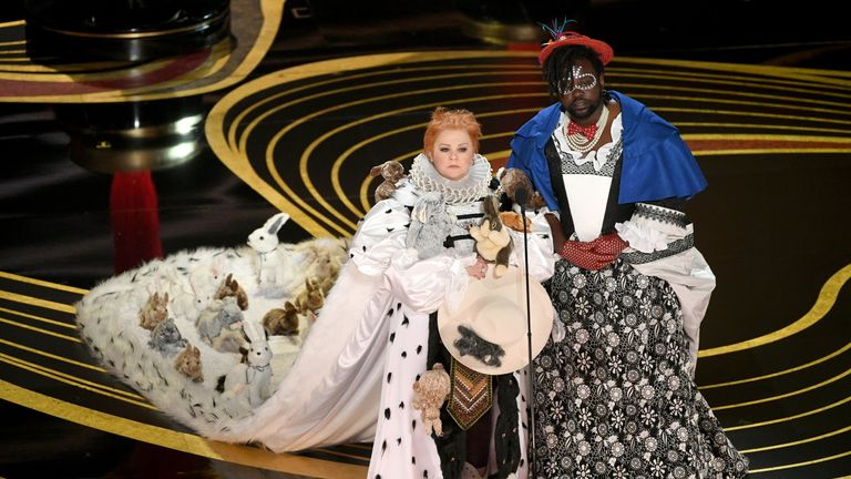 Melissa McCarthy and Brian Tyree Henry present the award for best costume