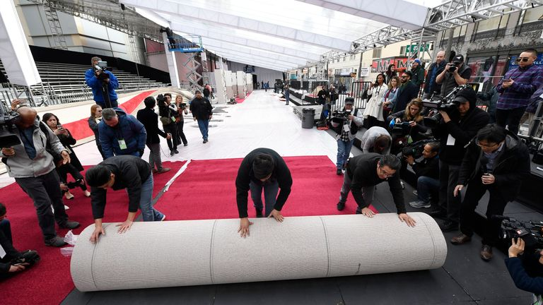 Oscars 2019: Workers roll out the red carpet in preparations for the 91st Academy Awards at Dolby Theatre in Hollywood, California