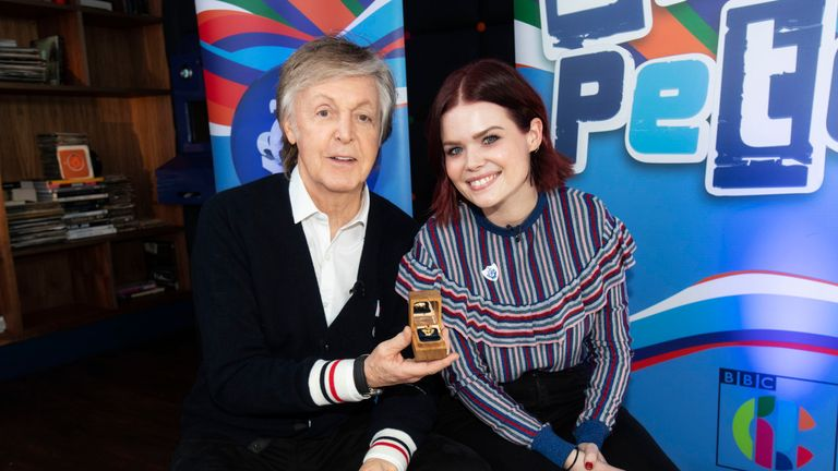 Sir Paul McCartney with Blue Peter presenter Lindsey Russell receiving his gold Blue Peter badge