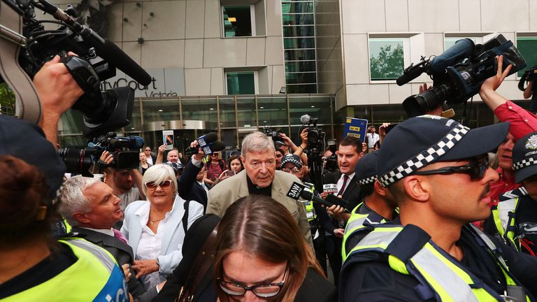Cardinal Pell leaves court after it ruled that his child abuse convictions could be made public