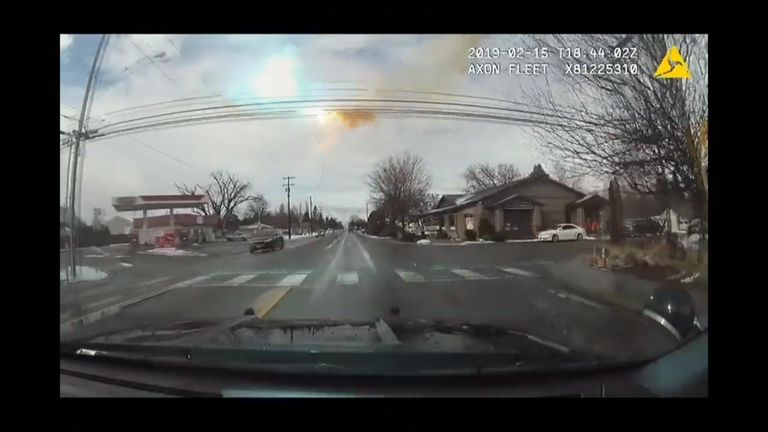A police officer avoided injury after a sparking power line hit his SUV in Lewiston, Idaho.