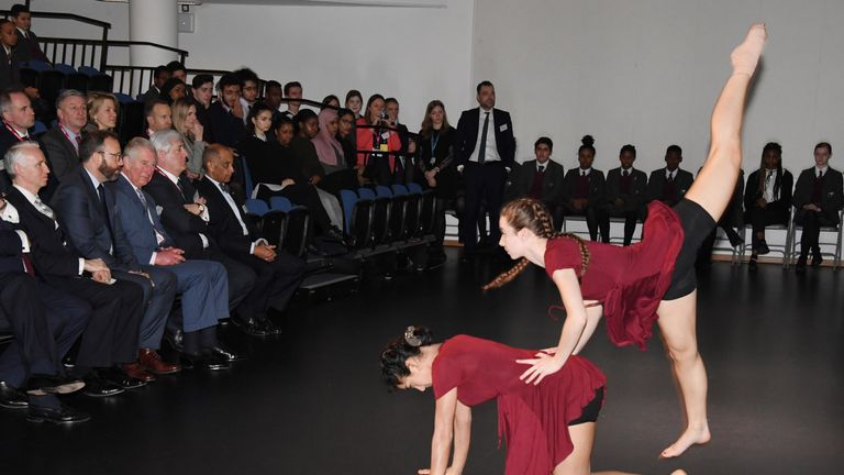 Prince Charles watches a performance at the Kensington school