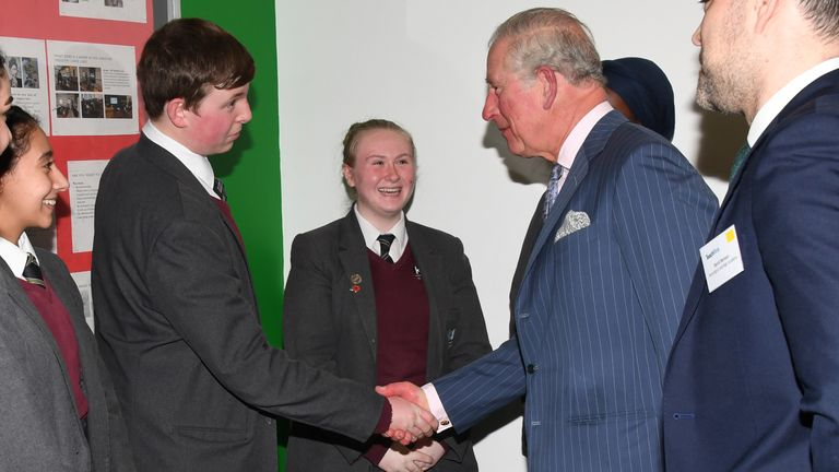 Charles shakes hands with some of the pupils, who were affected by the Grenfell fire