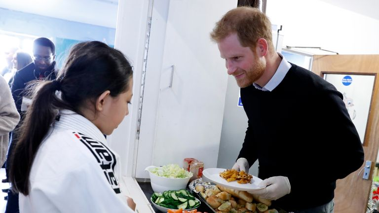 Prince Harry was serving lunch to help children get hot meals during school holidays
