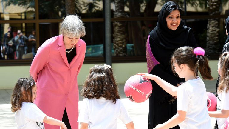 Princess Reema with Theresa May in 2017 as they spoke to girls during a basketball class in Riyadh