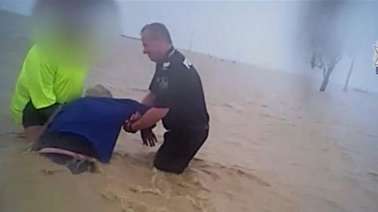 Police rescue a man in Queensland trapped by floods