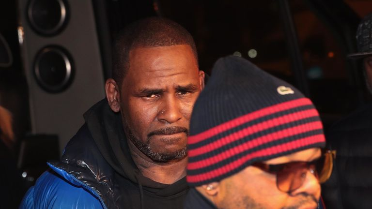 R Kelly is expected to be held overnight ahead of a court appearance on Saturday