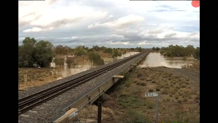 Surveillance footage showed a railway track that disappeared under rising waters during major flooding in Queensland, Australia.