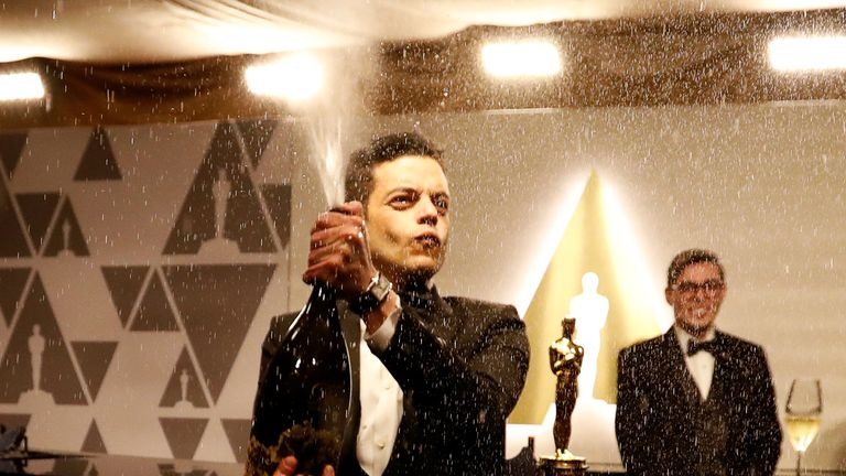 Rami Malek celebrates his Oscar win