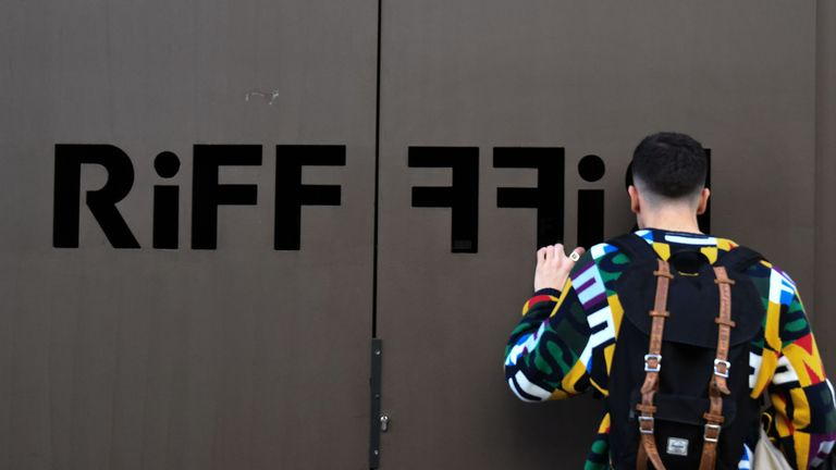 A man looks through the doors at Riff which has been closed since Tuesday
