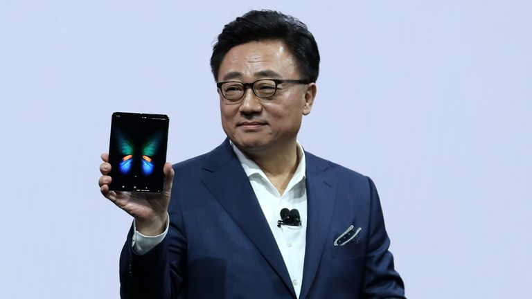 DJ Koh, the CEO of Samsung's mobile division, holds the  Samsung Galaxy Fold smartphone