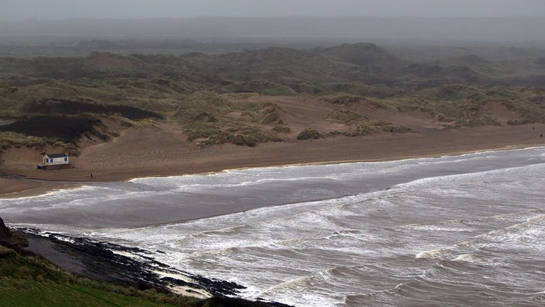 WOOLACOMBE, UNITED KINGDOM - JANUARY 04:  People walk along the beach at Saunton Sands on January 4, 2012 near Woolacombe, England. After being battered by wind and rain yesterday, the UK is expected to experience more bad weather over the next few days.  (Photo by Matt Cardy/Getty Images)