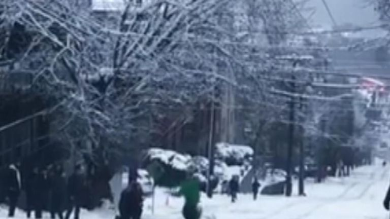Snowboarder flips 360 degrees in Seattle street
