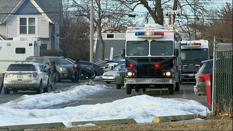 Officers respond to a mass shooting in Aurora, Illinois