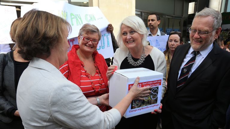 A group including MP Siobhain McDonagh (centre right) hands in a petition to Deborah Warman, Head of Reward outside Marks and Spencer's flagship store in Oxford Street, London, calling on the high street giant to scrap proposed pay cuts to offset the cost of the National Living Wage.