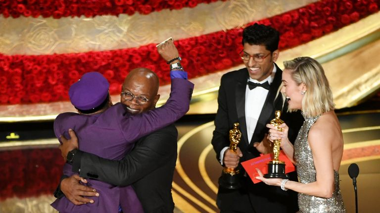 Spike Lee celebrates his award for best adapted screenplay