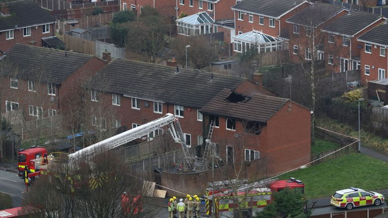 Firefighters at the scene of a house fire in Sycamore Lane, Stafford