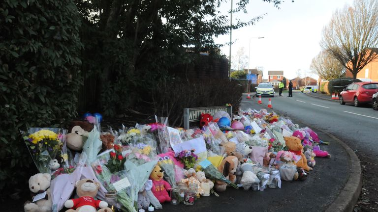 Flowers and teddies left in tribute to the four children who died in the fire