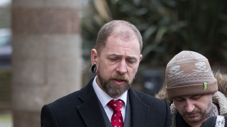 Brendan McCarthy, 50, (left) from Bushbury, Wolverhampton, who ran Dr Evil's Body Modification Emporium in Wolverhampton, leaves Wolverhampton Crown Court where he admitted causing grievous bodily harm to three customers by carrying out a tongue-splitting procedure and removing an ear and a nipple. PRESS ASSOCIATION Photo. Picture date: Tuesday February 12, 2019. McCarthy, changed his pleas to guilty on Tuesday after a two-year legal saga in which he unsuccessfully claimed the consent of his cus