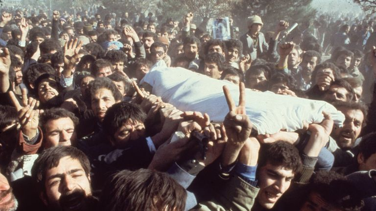 Mourners in Tehran carry the body of a demonstrator killed during the protests