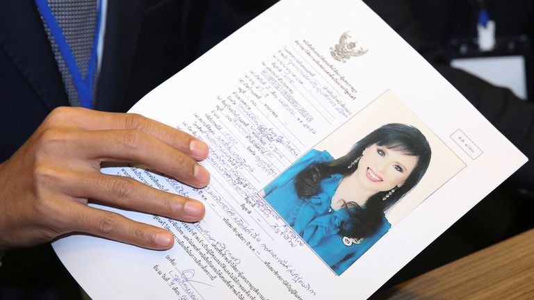 Thai Raksa Chart party leader Preechapol Pongpanich, holds up application of candidate for Prime Minister, Thailand's Princess Ubolratana Rajakanya Sirivadhana Barnavadi