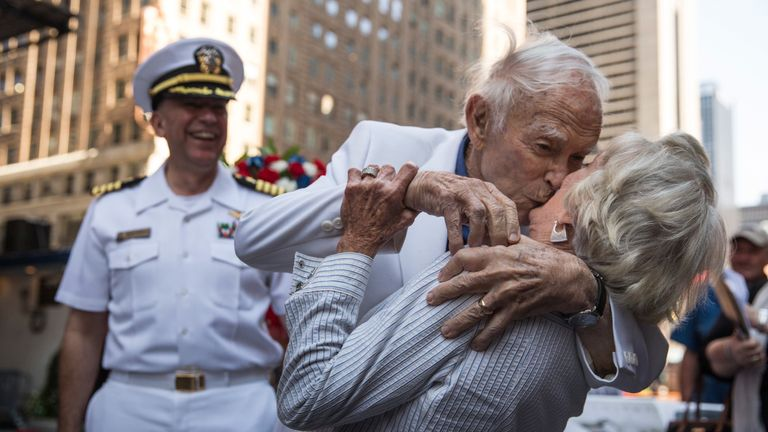Sydnor Thompson, 90, kisses his wife, Harriette Thompson, 91, while re-enacting the kiss