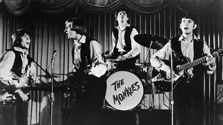 Peter Tork (second left) performs during an episode of The Monkees' TV show
