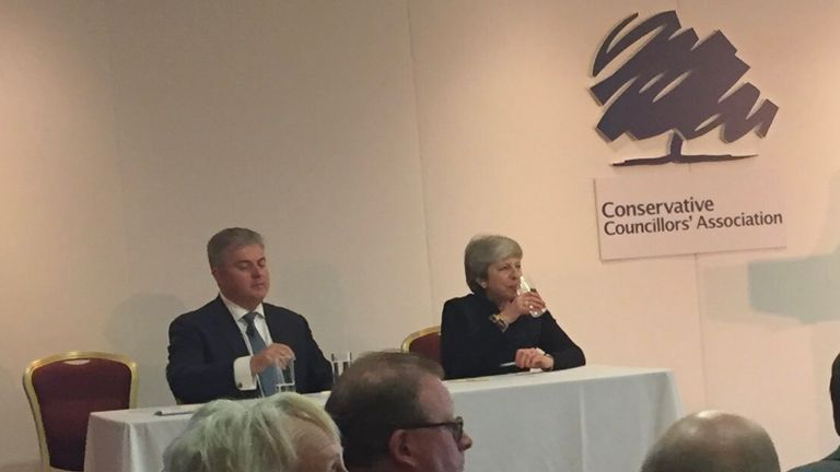 Theresa May told Tory grassroots members she was sad three MPs left the party this week