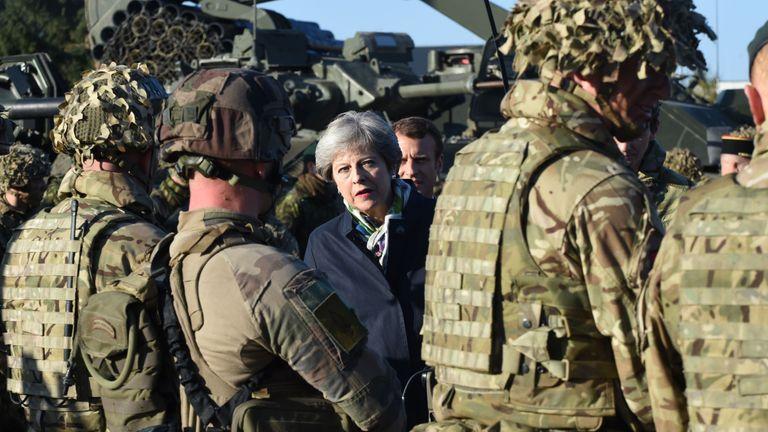 Theresa May visits troops at an Estonian military base