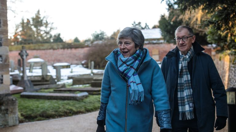 Theresa May attends church in Maidenhead with her husband ahead of a week of more negotiations