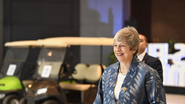 Theresa May arrives to the International Congress Centre in Sharm el-Sheikh