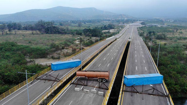 Desperate Venezuelans sell hair on border as military blocks aid
