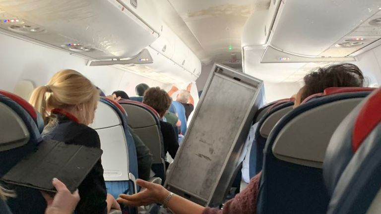 A drinks trolley was left on its side and liquid on the cabin roof. Pic: @JoeJustice0