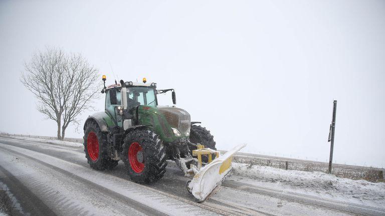 A snowplough clears a road near in Shaftesbury, Dorset