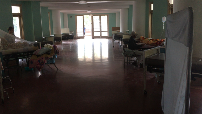 Relatives visit patients with no electricity in the hospital