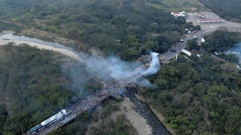 Smoke billowed from the trucks set alight on the bridge