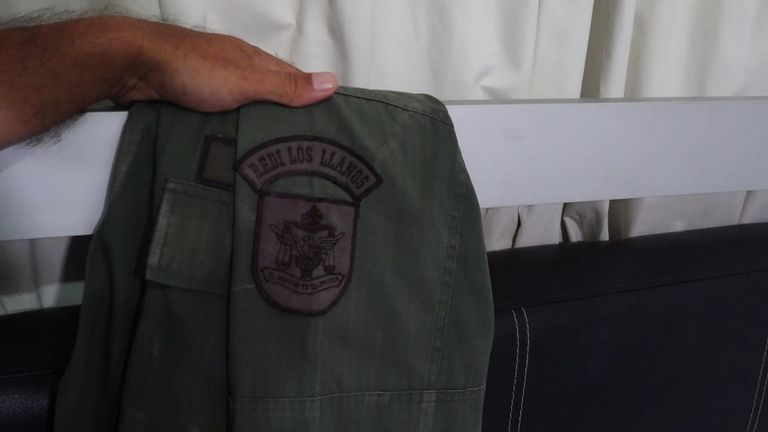 One of the defector shows the insignia on his uniform