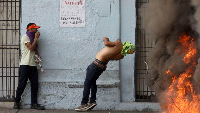 A protester is hit in the face by barbed wire during battles with guards in Urena