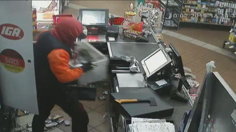 Robber with axe ransacks Melbourne shop