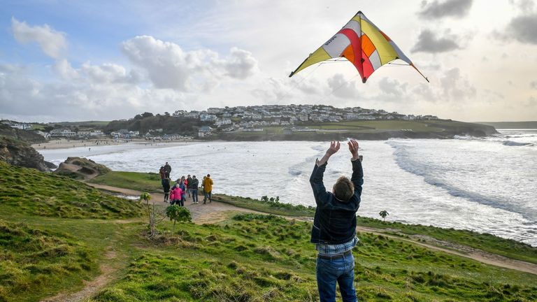 A man took advantage of the sunny weekend weather to fly a kite in New Polzeath, Cornwall
