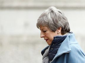 Theresa May arrives in Downing Street