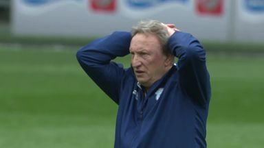 Warnock stares out officials