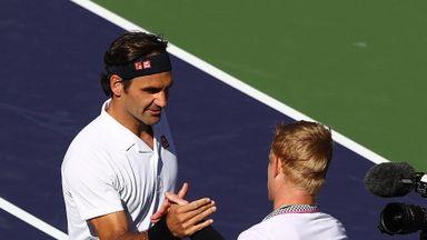 Federer eases past Edmund