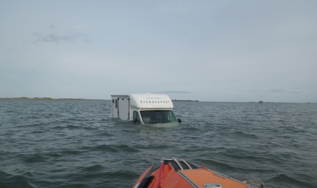Pair rescued as van is swamped by high tide on Holy Island causeway