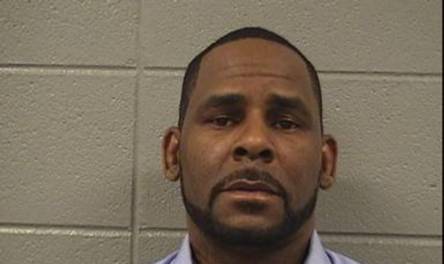R Kelly refused bail as prosecutor says singer is 'still a danger to young girls'