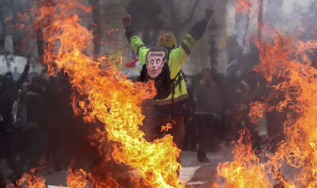 Emmanuel Macron pledges tax cuts in bid to quell yellow vest protests