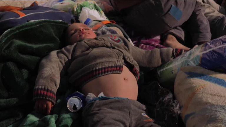 A boy sleeping in al Houl camp in Syria